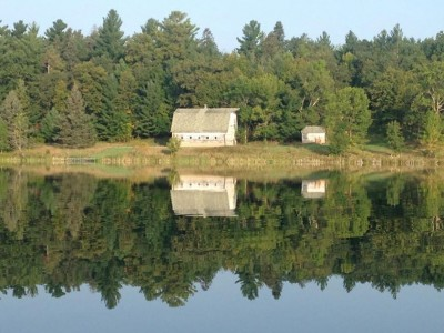 barn reflected in 11th cRow Wing lake, akeley, mn